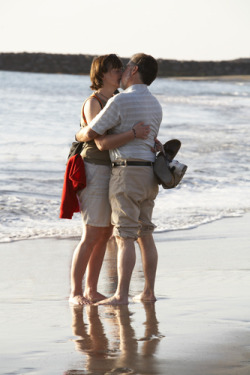 couple kissing on a beach