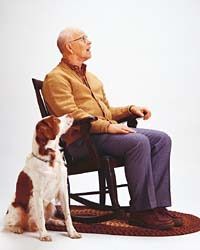 grandfather sitting with dog